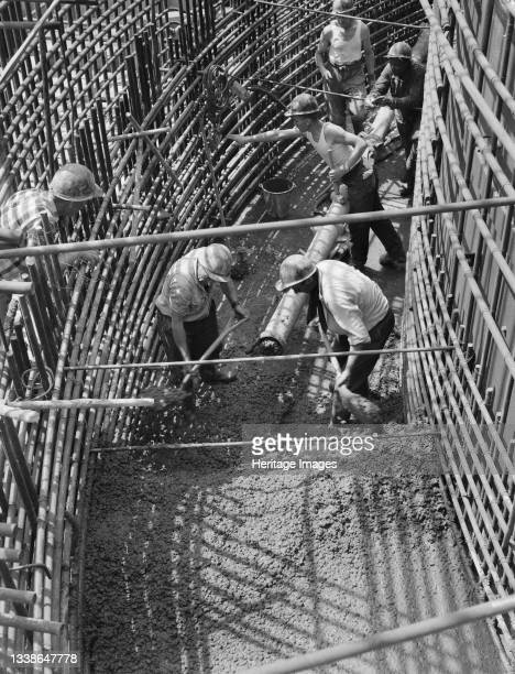 Team of workers, on lift 29 of the construction of Berkeley Nuclear Power Station, carrying out concreting operations on the biological shield of...