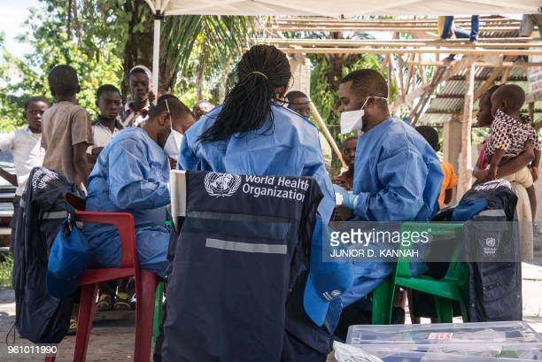 A team of World Health Organization members prepares to launch the Ebola vaccination drive in a neighborhood on the outskirts of Mbandaka on May 21...