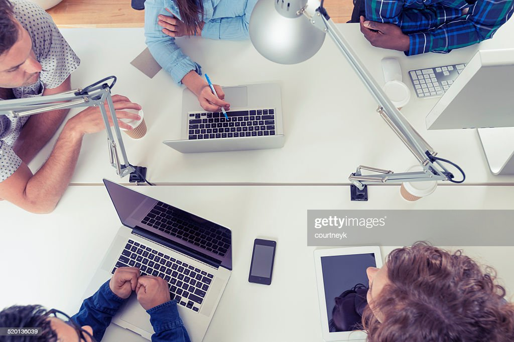 Team of young business people using technology in a meeting : Stock Photo