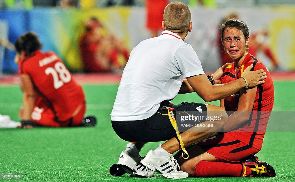 A team official comfort Tina Bachmann of : News Photo