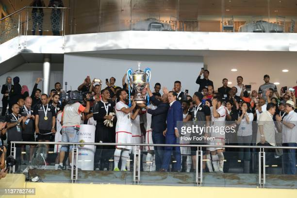Team Oman lifts the cup after defeating team Singapore in the penalty shooyout during the Airmarine Cup final between Singapore and Oman at Bukit...