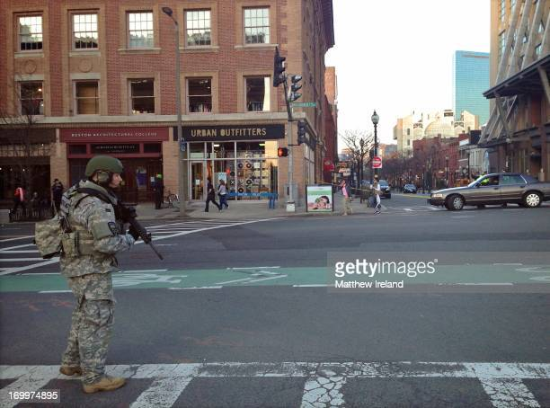 Team on Boston streets just a few hours after the horrific, terrorist bombings at the Boston Marathon. This SWAT team member stands ready at the...