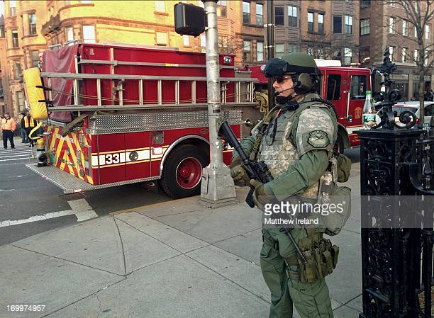 Team on Boston streets just a few hours after the horrific, terrorist bombings at the Boston Marathon. This SWAT team member stands at the corner of...