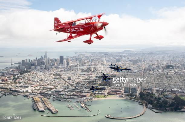 Team Oracle aerobatics pilot Sean D Tucker flies above the US Navy Blue Angels over San Francisco California as part of a practice run for Fleet Week...