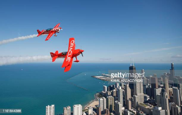 TOPSHOT Team Oracle Hall of Fame Air Show Performer Sean D Tucker and Jessy Panzer fly their aircrafts over Chicago as they prepare for the 61th...