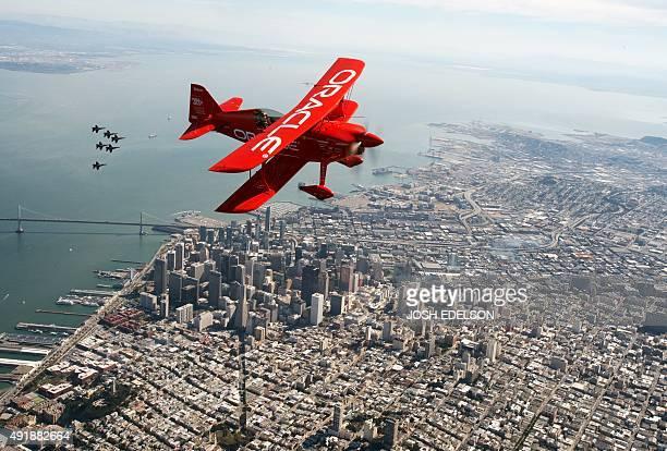 Team Oracle stunt pilot Sean Tucker flies ahead of the US Navy Blue Angels as part of a practice run for Fleet Week over San Francisco California on...
