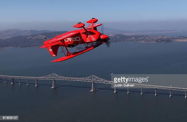 Team Oracle stunt pilot Sean Tucker flies upside down as he passes the Richmond San Rafael Bridge ahead of his Fleet Week performance October 8 2009...