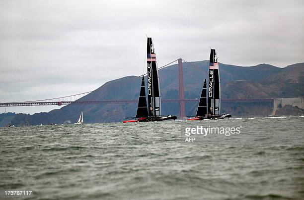 Team Oracle USA sails their two AC72 Racing Yachts near the Golden Gate Bridge during a training session for the America's Cup race in San Francisco...