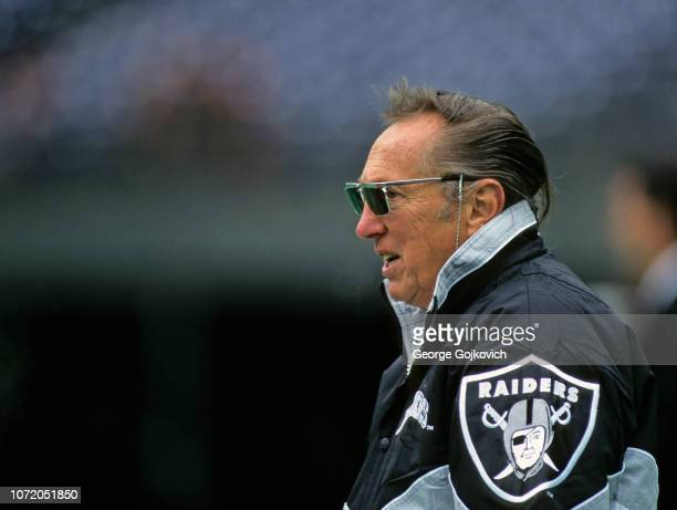 Team owner Al Davis of the Oakland Raiders looks on from the field before a game against the Cincinnati Bengals at Riverfront Stadium on November 5...
