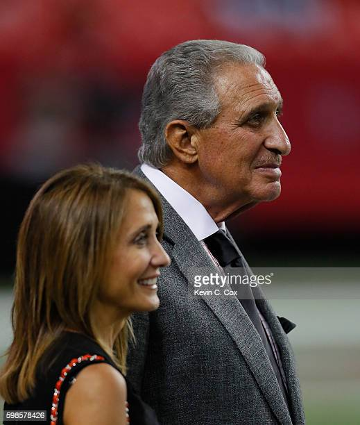 Team Owner Arthur Blank of the Atlanta Falcons and Angela Macuga looks on during the game against the Jacksonville Jaguars at Georgia Dome on...