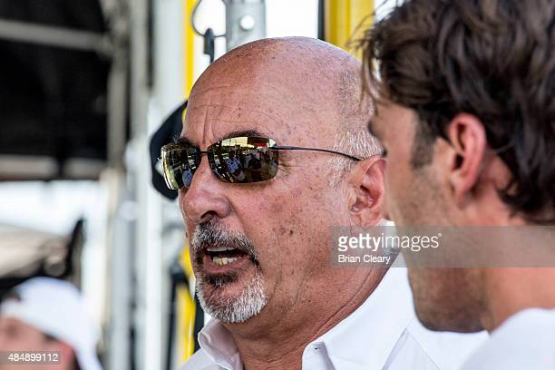 Team owner Bobby Rahal talks to his drivers after qualifying for the IMSA Tudor Series race at Virginia International Raceway on August 22 2015 in...