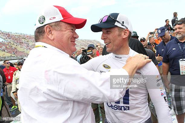 Team owner Chip Ganassi and Jamie McMurray, driver of the Cessna Chevrolet, embrace in victory lane after teammate Kyle Larson, driver of the Target...