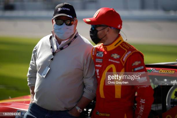 Team owner Chip Ganassi and Ross Chastain, driver of the McDonald's Chevrolet, talk on the grid prior to the NASCAR Cup Series O'Reilly Auto Parts...