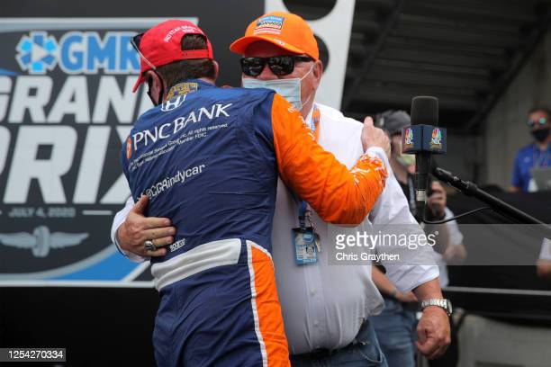 Team owner Chip Ganassi congratulates Scott Dixon, driver of the PNC Bank Chip Ganassi Racing Honda, in Victory Lane after winning the NTT IndyCar...