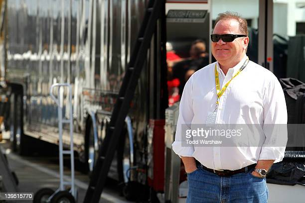 Team owner Chip Ganassi stands in the garage during practice for the NASCAR Sprint Cup Series Daytona 500 at Daytona International Speedway on...