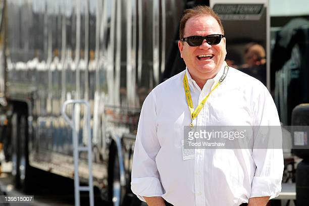 Team owner Chip Ganassi stands in the garge during practice for the NASCAR Sprint Cup Series Daytona 500 at Daytona International Speedway on...
