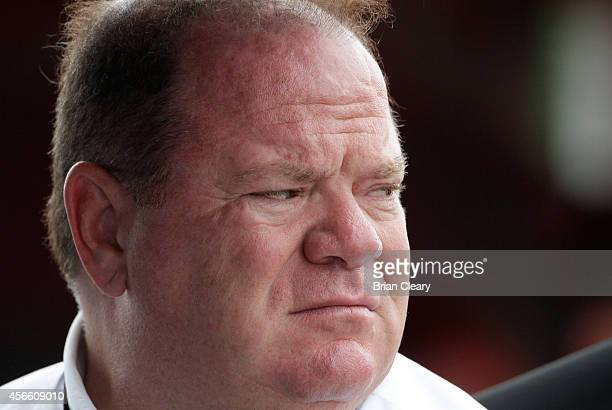 Team owner Chip Ganassi watches qualifying for Petit Le Mans at Road Atlanta on October 3 2014 in Braselton Georgia