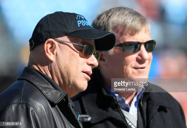 Team owner, David Tepper of the Carolina Panthers talks to Panthers General Manager, Marty Hurney, before their game against the Tennessee Titans at...