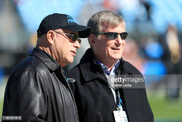 Team owner David Tepper of the Carolina Panthers talks to Panthers General Manager Marty Hurney before their game against the Tennessee Titans at...