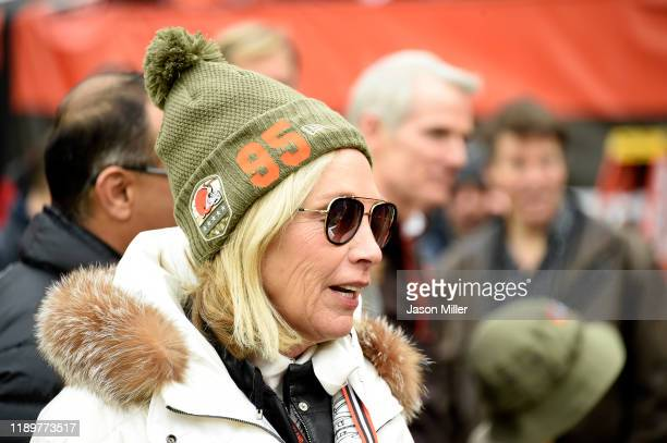 Team owner Dee Haslam of the Cleveland Browns talks with guests on the sidelines while wearing a hat supporting defensive end Myles Garrett prior to...