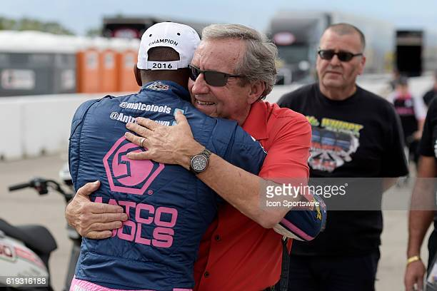 Team owner Don Schumacher hugs Antron Brown Don Schumacher Racing NHRA Top Fuel Dragster after Brown clinched the NHRA Top Fuel championship during...