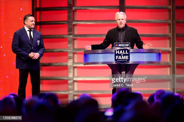 Team owner Gene Haas officially inducts Tony Stewart into the NASCAR Hall of Fame during the 2020 NASCAR Hall of Fame Induction Ceremony at Charlotte...