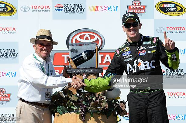 Team owner Jack Roush and Carl Edwards driver of the Aflac Ford celebrates in victory lane after winning the NASCAR Sprint Cup Series Toyota/Save...