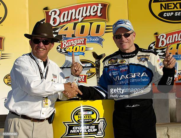 Team owner Jack Roush and Mark Martin, driver of the Viagra Ford, celebrate winning the NASCAR Nextel Cup Series Banquet 400 on October 9, 2005 at...
