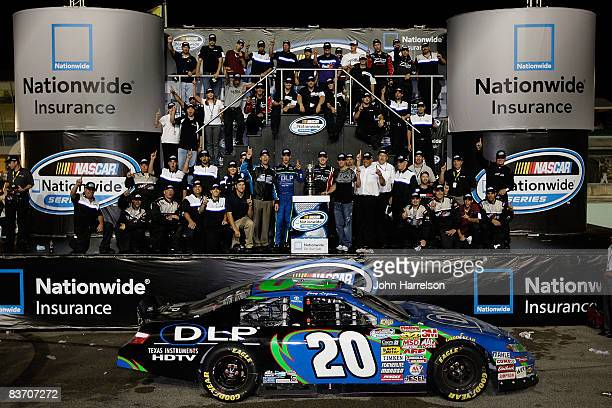 Team owner JD Gibbs poses with drivers and team members after winning the NASCAR Nationwide Series Owners Championship after the NASCAR Nationwide...