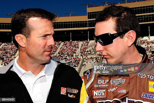 Team owner JD Gibbs speaks with his driver Kyle Busch driver of the MM's Toyota on the starting grid prior to the start of the NASCAR Sprint Cup...