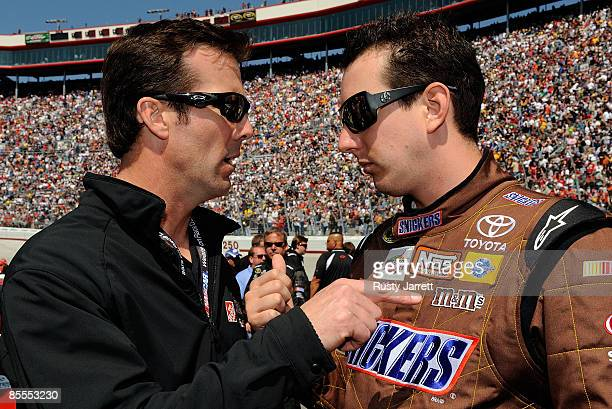 Team owner JD Gibbs talks with Kyle Busch driver of the Snickers Toyota on the grid prior to the NASCAR Sprint Cup Series Food City 500 at Bristol...