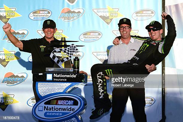 Team owner Joe Gibbs car owner JD Gibbs and Kyle Busch driver of the Monster Energy Toyota celebrates in victory lane after winning the NASCAR...
