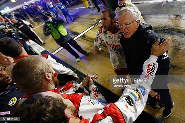 Team owner Joe Gibbs celebrates a Carl Edwards driver of the Sport Clips Toyota victory in the rainshortened NASCAR Sprint Cup Series AAA Texas 500...
