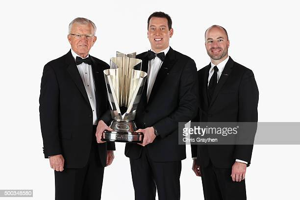 Team owner Joe Gibbs NASCAR Sprint Cup Series Champion Kyle Busch and crew chief Adam Stevens pose for a portrait during the 2015 NASCAR Sprint Cup...