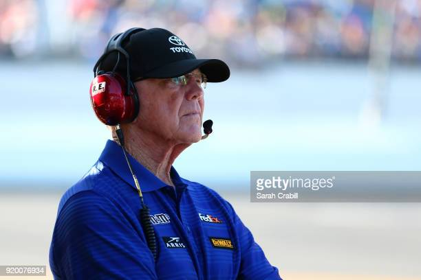 Team owner Joe Gibbs stands on pit road during the Monster Energy NASCAR Cup Series 60th Annual Daytona 500 at Daytona International Speedway on...