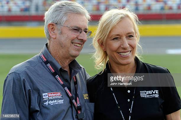 Team owner Leonard Wood poses with former tennis player Martina Navratilova on the grid during qualifying for the NASCAR Sprint Cup Series CocaCola...
