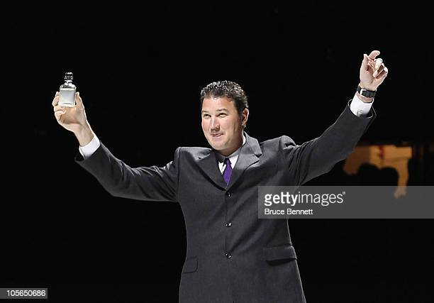 Team owner Mario Lemieux of the Pittsburgh Penguins accompanied with water from the Mellon Arena salutes the crowd prior to the arena opening game...