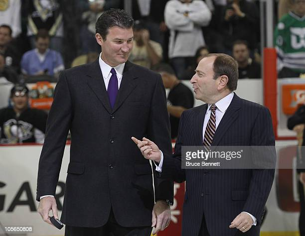 Team owner Mario Lemieux of the Pittsburgh Penguins and NHL commissioner Gary Bettman arrive for the opening faceoff between the Penguins and the...