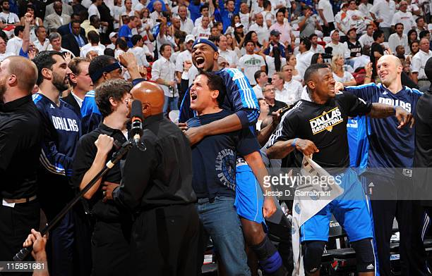 Team owner Mark Cuban and Brendan Haywood of the Dallas Mavericks celebrate after winning the NBA Championship by defeating the Miami Heat during...