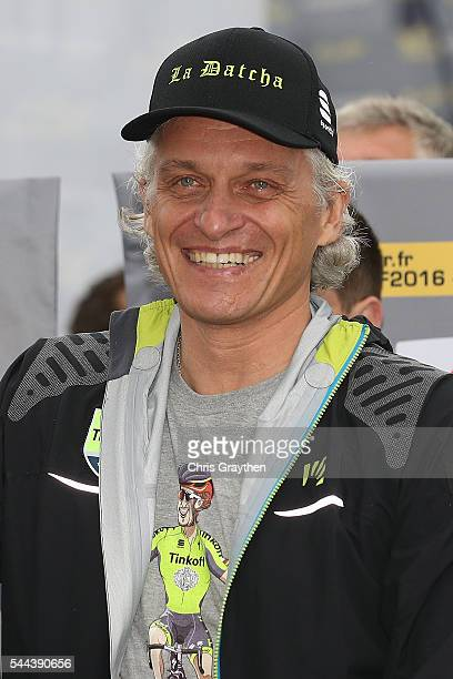 Team owner Oleg Tinkov gestures after Peter Sagan of Slovakia riding for Tinkoff wins stage two and takes the yellow leader's jersey during stage two...