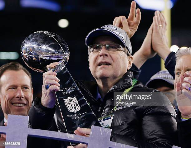 Team owner Paul Allen of the Seattle Seahawks celebrates with the Vince Lombardi trophy after defeating the Denver Broncos 438 in Super Bowl XLVIII...