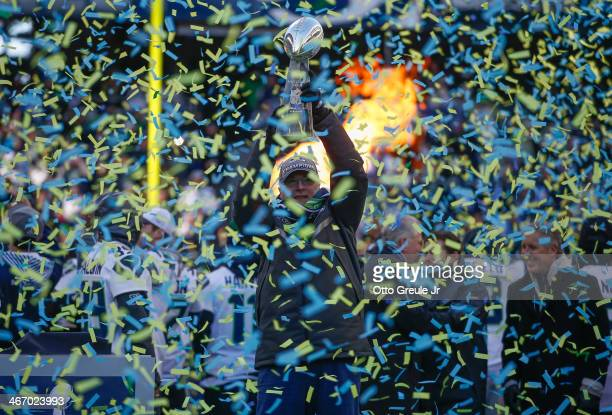 Team Owner Paul Allen of the Seattle Seahawks holds the Lombardi Trophy during ceremonies following the Super Bowl XLVIII Victory Parade at...
