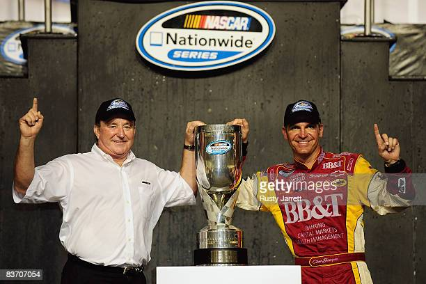 Team owner Richard Childress and Clint Bowyer, driver of the BB&T Chevrolet, pose after winning the 2008 NASCAR Nationwide Series Championship after...