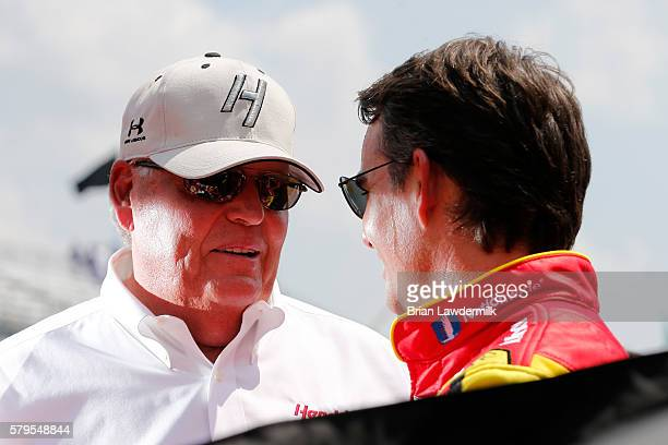 Team owner Rick Hendrick and Jeff Gordon driver of the Axalta Chevrolet stands on the grid prior to the NASCAR Sprint Cup Series Crown Royal Presents...