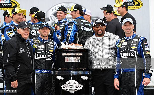 Team owner Rick Hendrick poses with Jimmie Johnson driver of the Lowe's Chevrolet former NFL player Ray Lewis and crew chief Chad Knaus in victory...