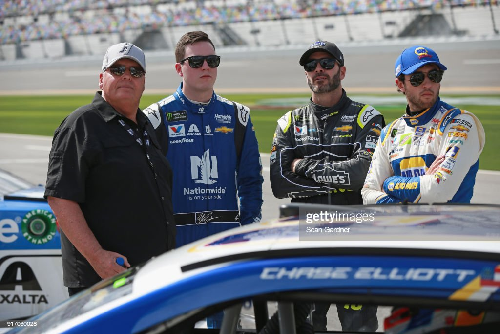 Team owner, Rick Hendrick, stands with Alex Bowman, driver of the #88 Nationwide Chevrolet, Jimmie Johnson, driver of the #48 Lowe's for Pros Chevrolet, and Chase Elliott, driver of the #9 NAPA Auto Parts Chevrolet, during qualifying for the Monster Energy NASCAR Cup Series Daytona 500 at Daytona International Speedway on February 11, 2018 in Daytona Beach, Florida.