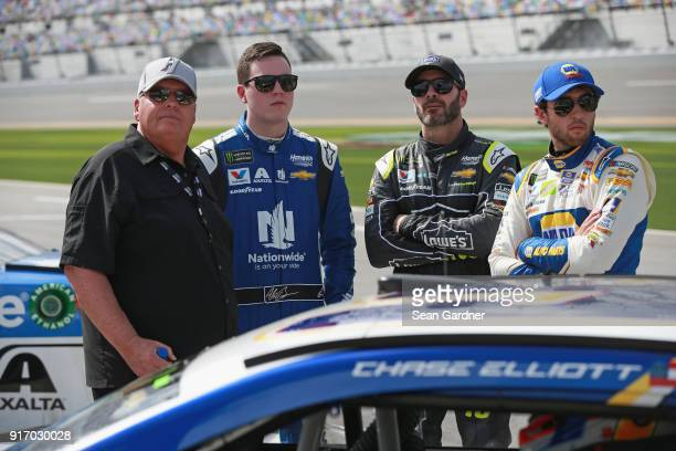 Team owner Rick Hendrick stands with Alex Bowman driver of the Nationwide Chevrolet Jimmie Johnson driver of the Lowe's for Pros Chevrolet and Chase...
