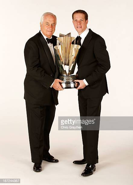Team owner Roger Penske and 2012 NASCAR Sprint Cup Series Champion Brad Keselowski driver of the Miller Lite Dodge hold the championship trophy as...