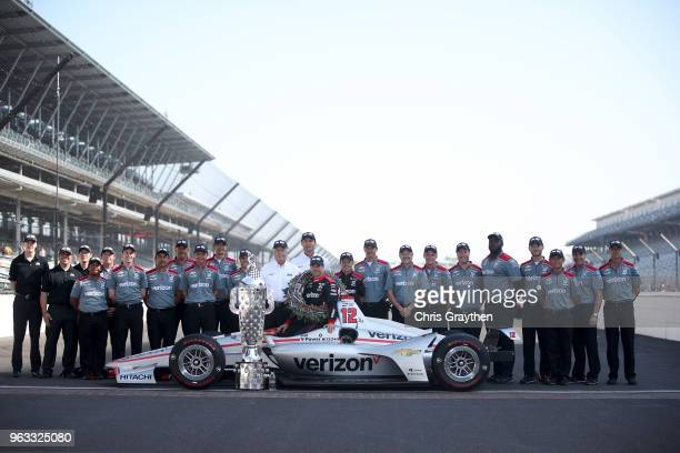 Team owner Roger Penske and Will Power of Australia driver of the Verizon Team Penske Chevrolet pose for a photo after winning the 102nd Running of...