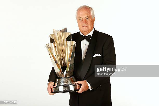 Team owner Roger Penske holds the championship trophy won by Penske driver and 2012 NASCAR Sprint Cup Series Champion Brad Keselowski driver of the...